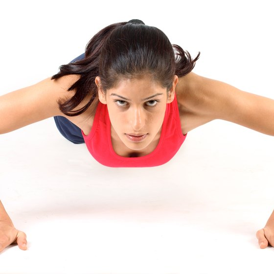Pushups are one type of exercise that lift and tone the muscles behind your breasts.