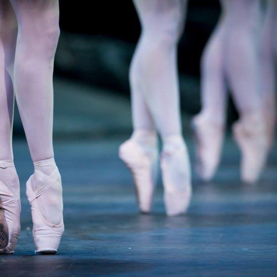 Stretching and strengthening the ankles, toes and arches can contribute to how well a ballet dancer can point her feet.