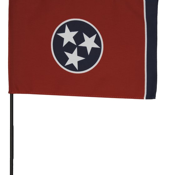 The three stars in the middle of the flag symbolize the three major geographic areas of Tennessee.