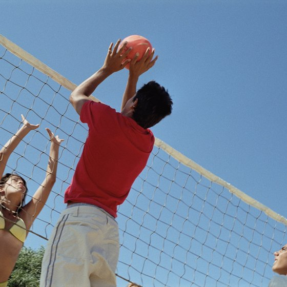 Blocking a spike isn't considered a hit in volleyball.
