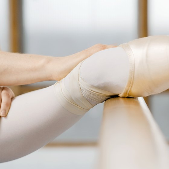 The ballet barre is a great tool to use when stretching your hamstrings.