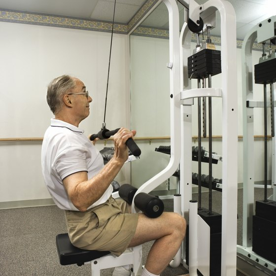 The lat pulldown machine works the back and biceps.