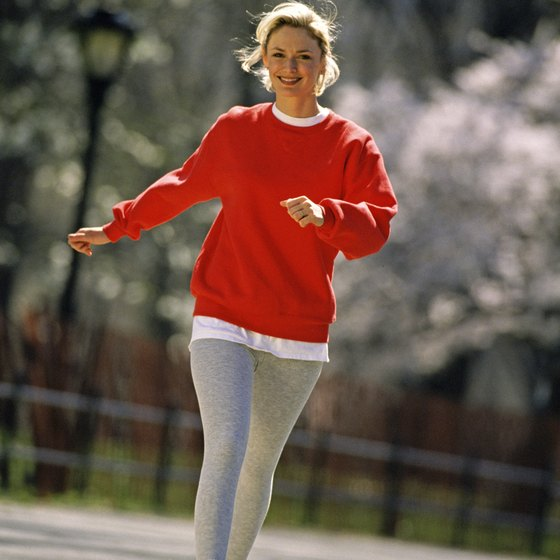 Walk without holding any weights to avoid bulky arms.