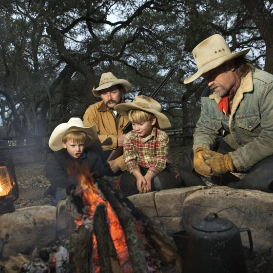 Tell stories around the campfire at a dude ranch.