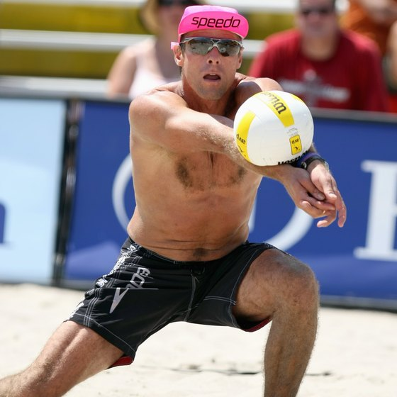 Karch Kiraly displays sculpted delts and biceps as he digs the ball.