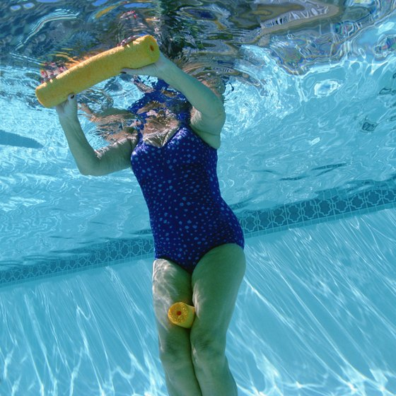 Water aerobics can be performed alone or in a group.
