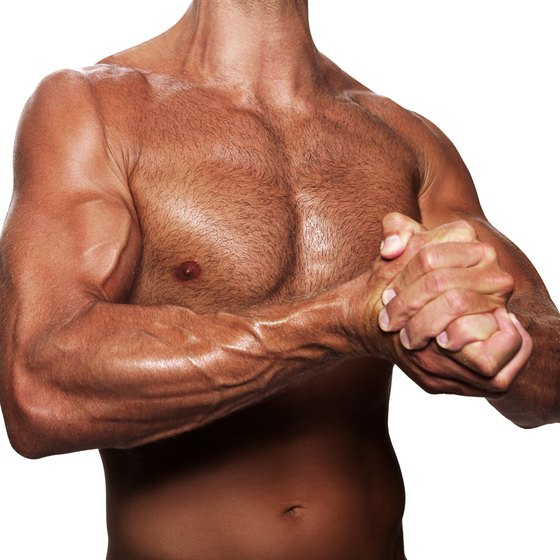 Isometric chest presses will build your pectoral muscles.