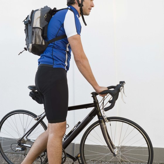 A backpack alters your weight and center of gravity while you are cycling.