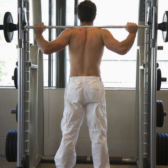 The barbell squat is one of five essential strength-training exercises.