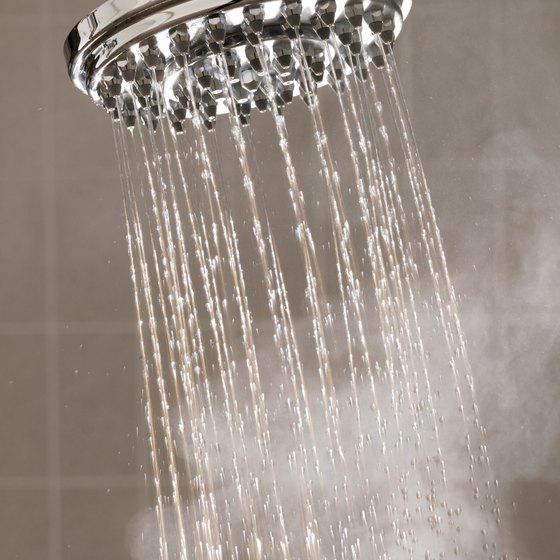 A hot shower or bath provides moist heat to help relax muscle knots.