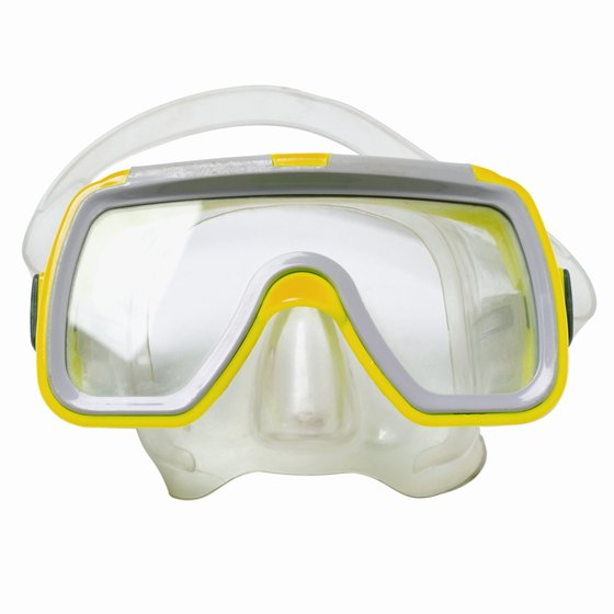 A dive mask won't correct vision, but those with corrective lenses will.
