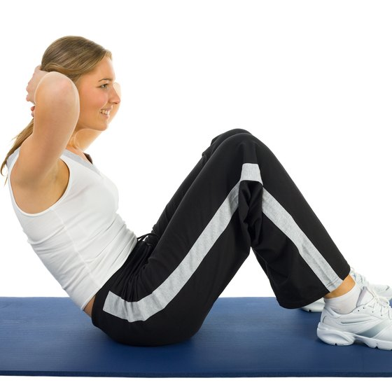 Proper form can reduce strain when you do situps.