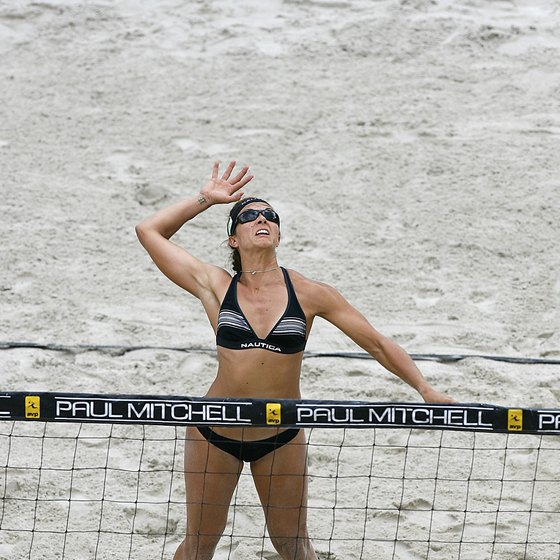 Misty May-Treanor leaps to attack the ball.