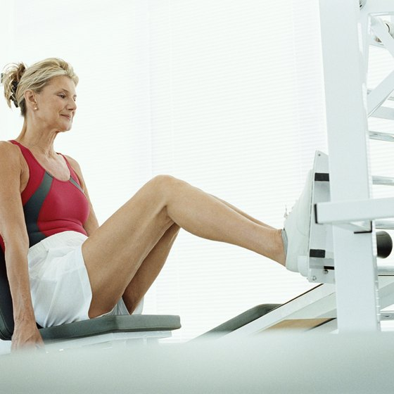 Use a machine to complete the leg press.