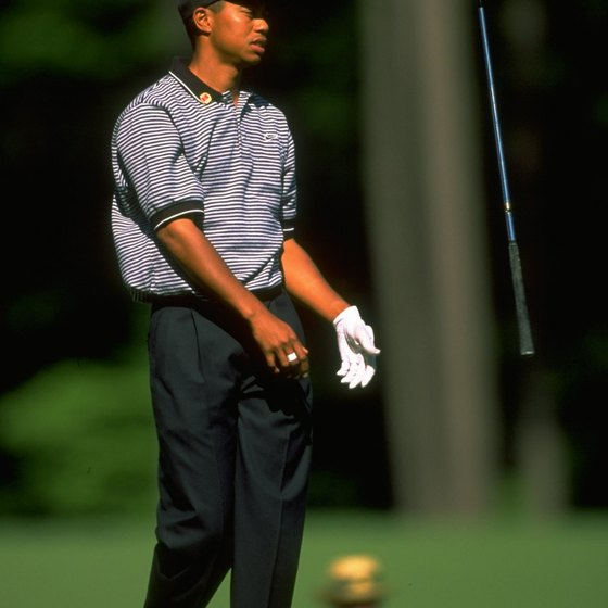 Tiger Woods shows his frustration after a poor shot in the first round of the 1997 Masters. Woods overcame an eight-shot deficit to win the tournament.