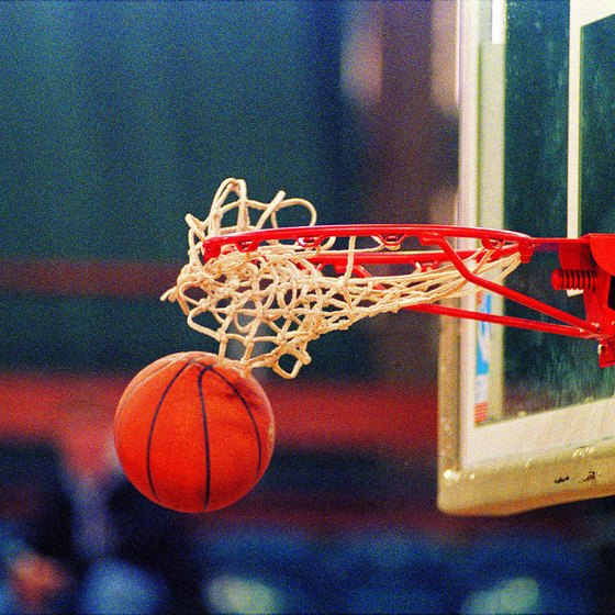 Glass backboards are standard in pro and college basketball.