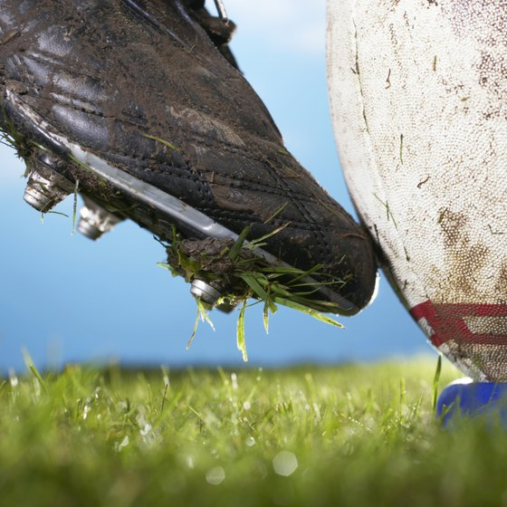 Cleated shoes help prevent athletes from falling on grass.