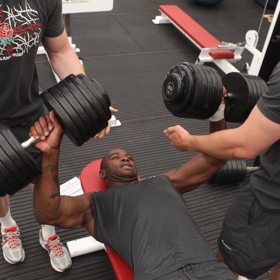 Dumbbell bench presses allow you to use a more natural range of motion.
