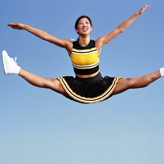 Toe touches are one example of cheer moves that require flexibility, strength and endurance.