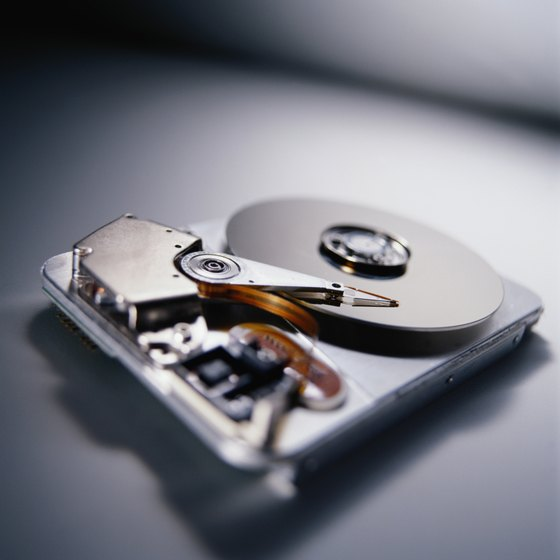 Hard drives typically use solid state cells and, more commonly, magnetic plates to store data.