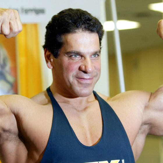Lou Ferrigno displays his Hulk-like arms.