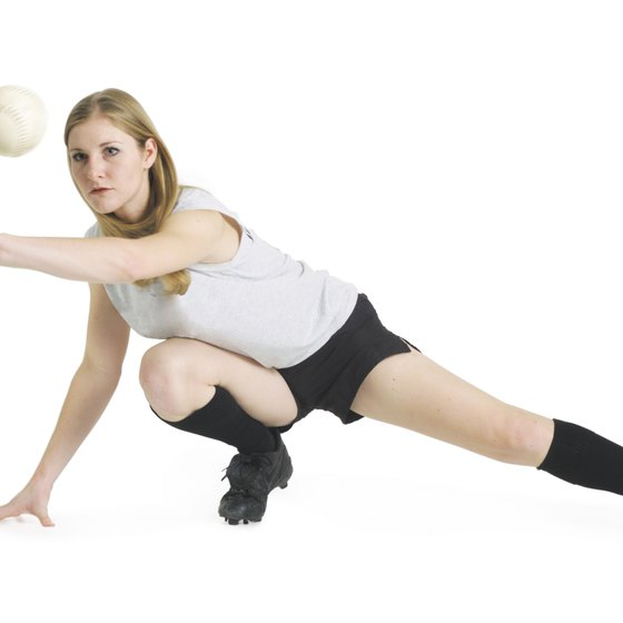 Avoid jerky or bouncy motion when stretching your legs for softball.