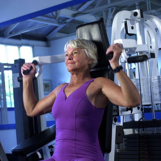An overhead press works the shoulder muscles.