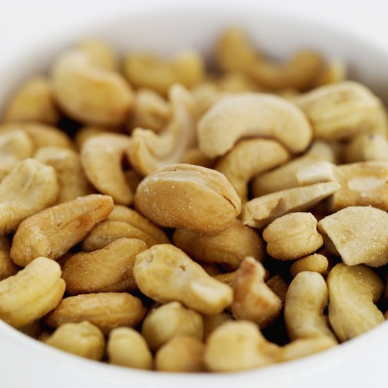 Cashews contain more iron and copper, but less fiber, than almonds.