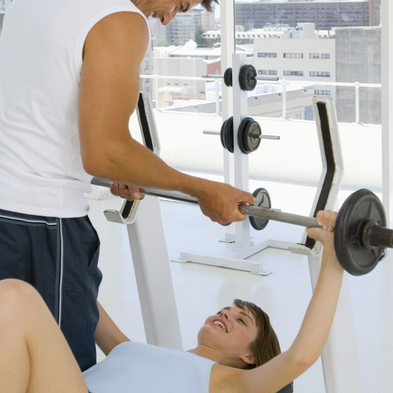 Bench pressing can be done with a bar or with free weight dumbbells.