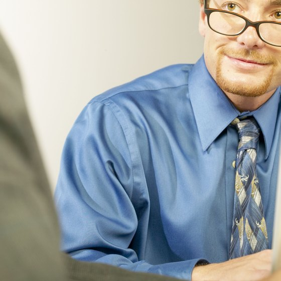 Conduct a performance evaluation in private to preserve confidentiality.