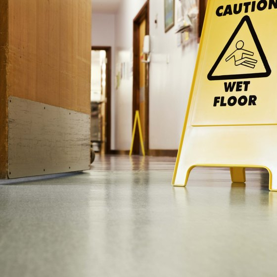 Warning shoppers about floor conditions can deter accidents.