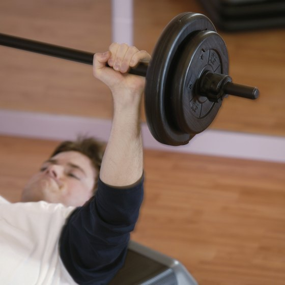 The bench press simultaneously works the chest, shoulders, and triceps.