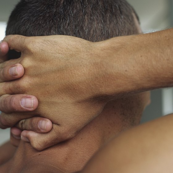 Creating resistance with your hands is one way to strengthen the neck on a daily basis.