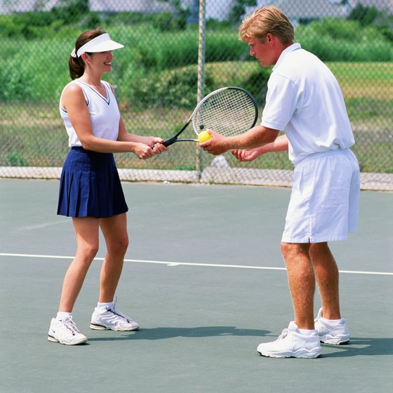 To improve at tennis, take lessons from a tennis professional.