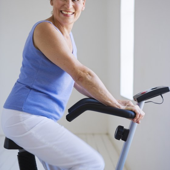 Riding an exercise bike is helpful in reducing belly fat.