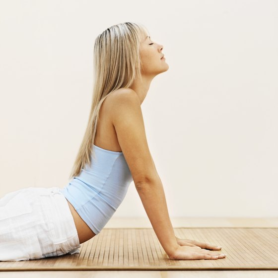 Stress-busting yoga may help bust visceral fat.