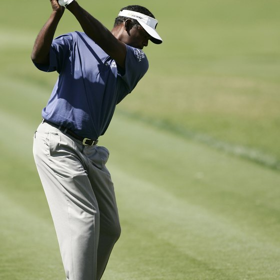 With his left shoulder tucked under his chin and his right elbow bent at 90 degrees, Vijay Singh has made a full shoulder turn.