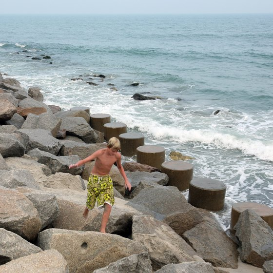 Exploring the rocks along the southern end of Kure Beach is just one of many activities for vacationers.