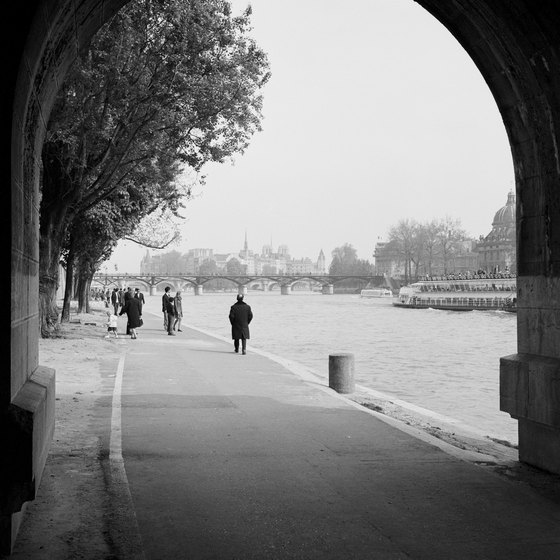 Pack layers to keep warm when walking along the scenic Seine river.