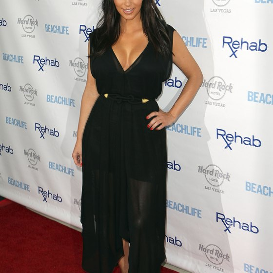Kim Kardashian, well known for her curves, sticks with cinched waists and lower necklines.