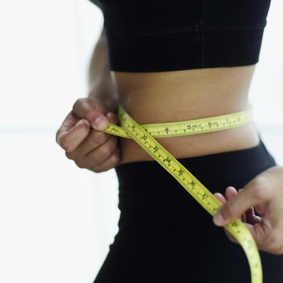 You can use a tape measure to track the circumference of your waistline.