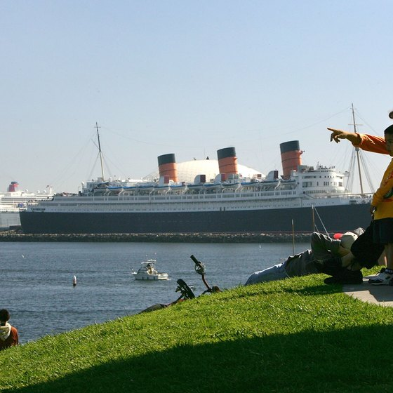 The Queen Mary permanently docked in Long Beach, shadowed by the Queen Mary II, still afloat.