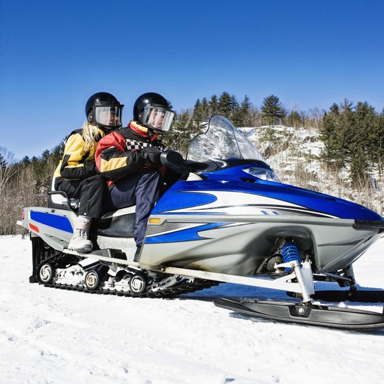 Steering a snowmobile burns calories.