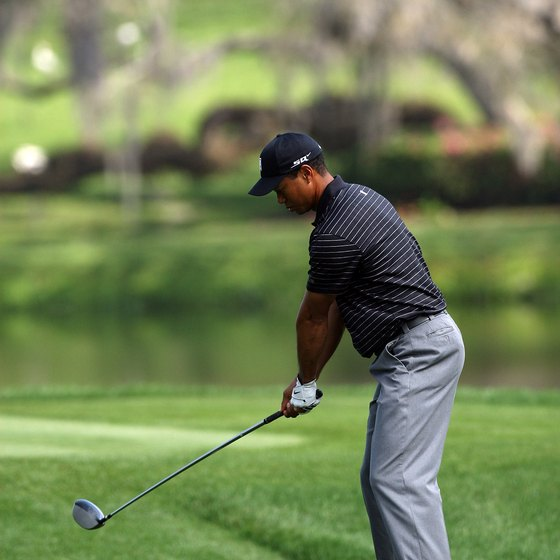 "Tiger Woods believes in taking the club back ""low and slow."""
