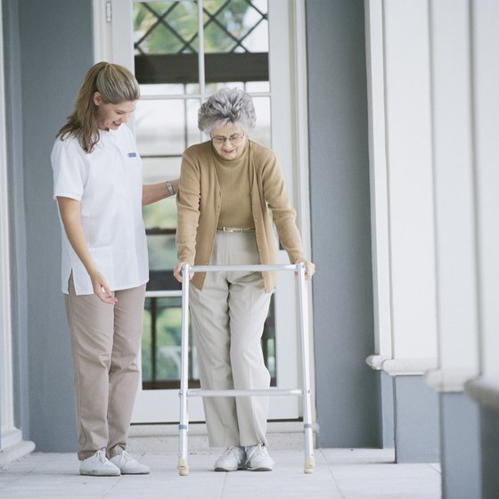 A nurse helps an elderly patient at a nursing home.
