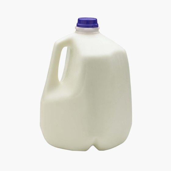 Fill an empty milk jug with sand or water for a kettlebell substitute.