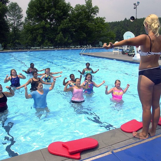 Aqua aerobics is performed partially submerged in a pool or other body of water.