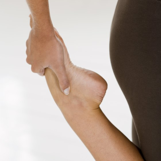 Keep your knees together and bend one leg behind your buttocks to stretch your quads.