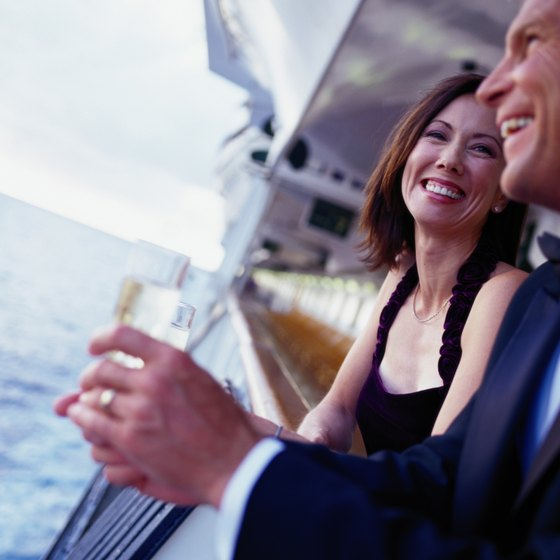 Enjoy champagne on the balcony of your suite as VIP cruise travelers.