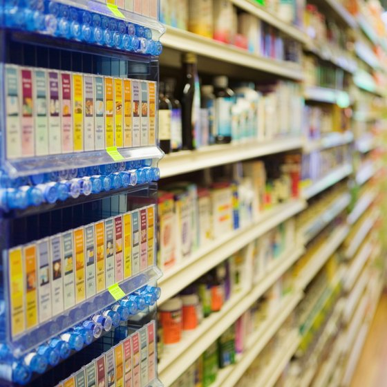 Product displays are arranged according to a plan-o-gram.